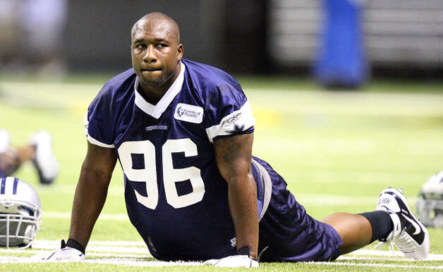 Dallas Cowboys defensive end Marcus Spears stretches during Saturday's drills.