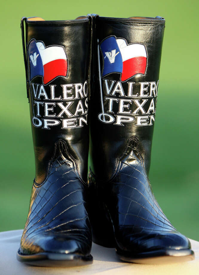 A pair of boots presented to Adam Scott, from Queensland, Australia, for winning the Valero Texas Open. / eaornelas@express-news.net