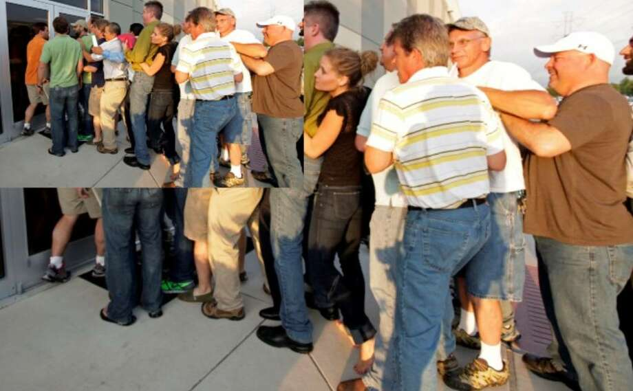 Developers bunch up as they line up to submit applications for CPS Energy's Solartricity producers program at the offices on Green Mountain Road Tuesday.