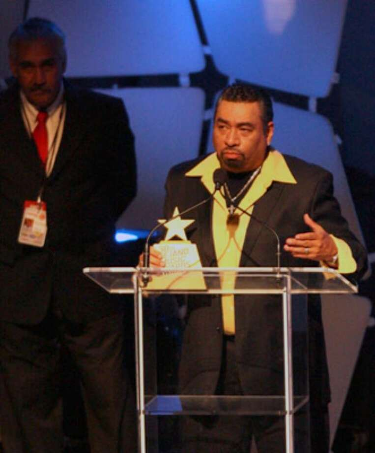 Jay Perez accepts the award for male vocalist of the year. The three-hour awards show experienced a few technical difficulties, but host Paul Rodriguez said the presentation is proof Tejano is not dead.