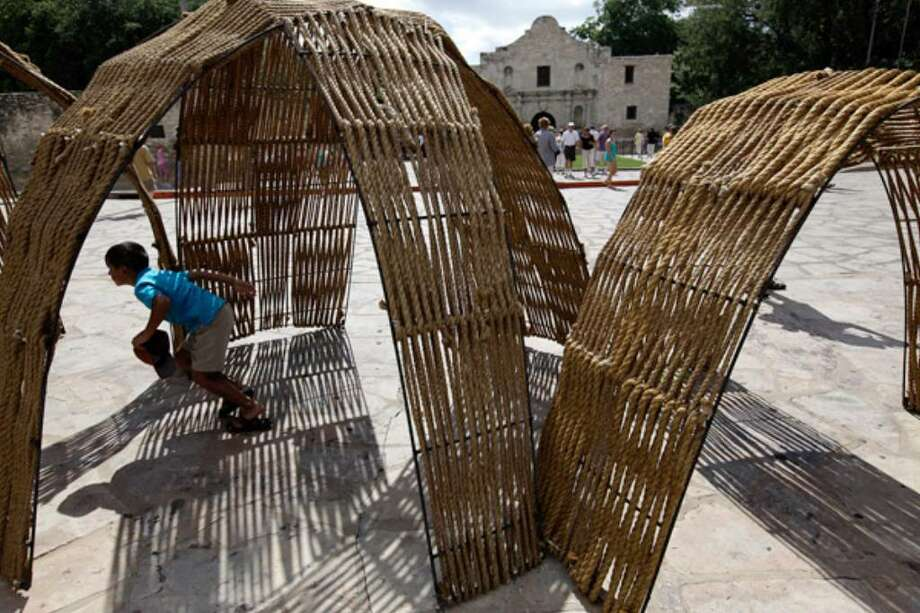 Temo Gonzalez, 5, of Houston, plays in a fort on display at Alamo Plaza. The fort was designed and built by architect students from the University of Texas at San Antonio.
