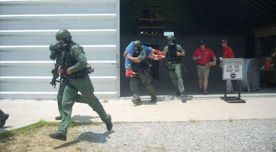 Members of San Antonio Police Department's eight-member SWAT competition team carry a dummy while being judged in the annual U.S. National SWAT Championship in Tulsa, OK. The San Antonio team placed second but won amongst national teams, qualifying for the 2011 counter-terror competition in Germany. San Antonio's team will be the first U.S. team to be represented in the international event next year.