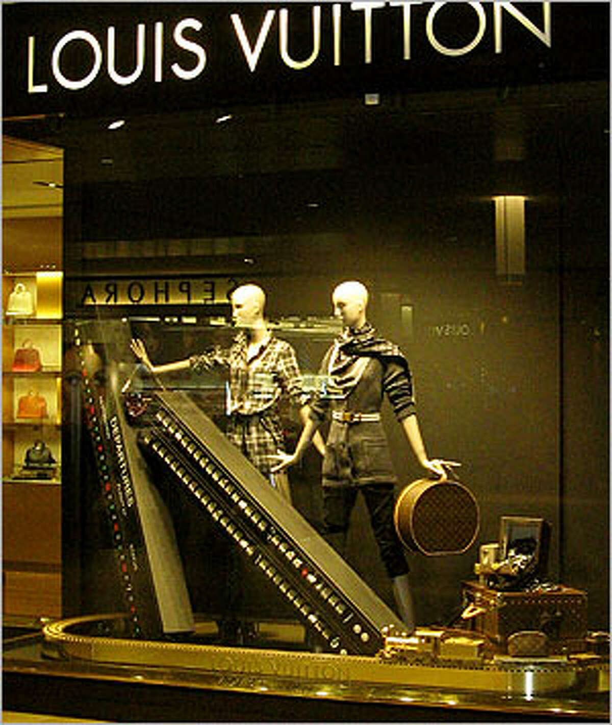 A gold train running on gold tracks hints of the opulence inside the Louis Vuitton store.