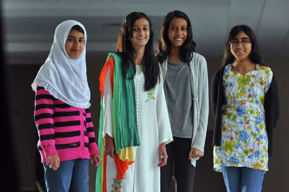 from left to right-Maliha Memon, 9, Sana Effendi, 11, Iman Ahmed, 13, and Nabeeha Noor, 13, have raised money by selling snacks to aid flood victims in Pakistan.  They were photographed at the Islamic Center of the Capital District on Sunday October 31, 2010 in Colonie, NY.  ( Philip Kamrass / Times Union ) Photo: Philip Kamrass