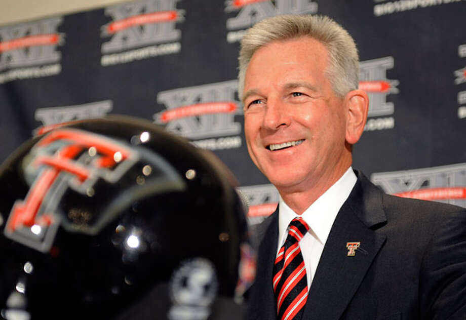 First-year Texas Tech football coach Tommy Tuberville speaks with reporters during Big 12 media days in Irving.