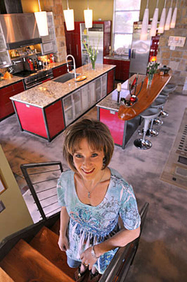 Mardi Smith's kitchen is in the center of the living area in a five-level house designed by her husband, Joe. / Copyright 2010 by Robin Jerstad, Jerstad Photographics LLC, all rights reserved. www.JerstadPhoto.com