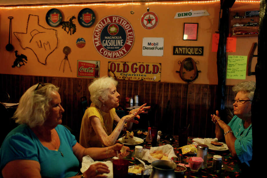 Friday, July 16 Sisters Dorothy Harrison, from left, a 25-year resident, and Jean Harrison, a 35-year resident, eat with lifelong Cotulla resident Fay Schulze at Uncle Moe's Country Kitchen in Cotulla. Jean Harrison owns La Salle Motel and it's been full for three months. Improved oil technology has launched a new era in once-sleepy Cotulla. Less than a year ago, the Eagle Ford Shale formation began turning long-slumbering Cotulla into a classic Texas boomtown, complete with instant millionaires, wild rumors and absolute uncertainty. / SAN ANTONIO EXPRESS-NEWS