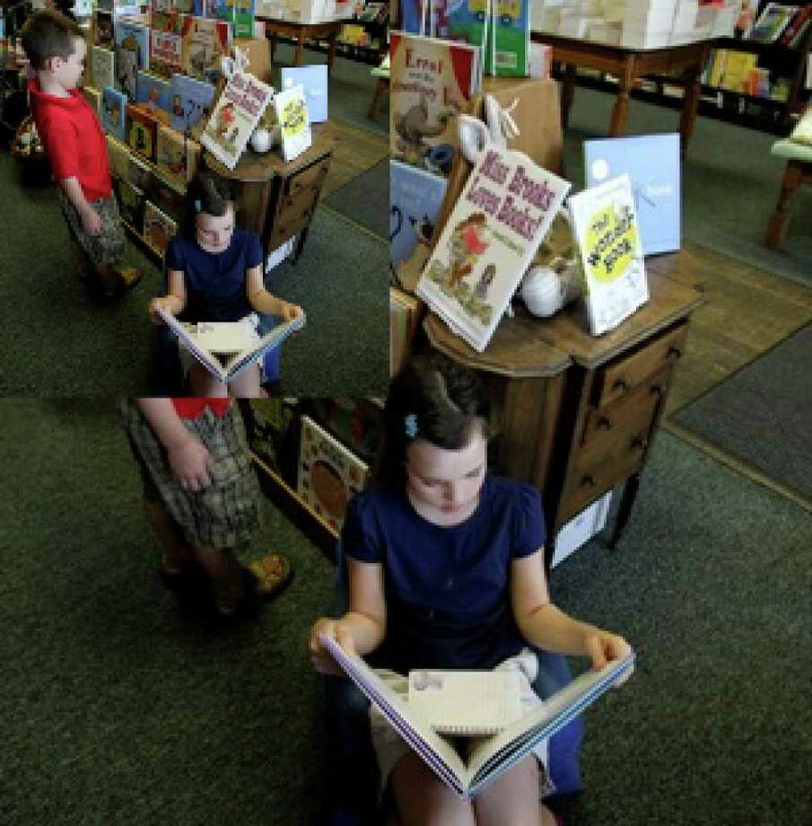 Kiley Hatch, 9, reads as her brother, John Austin Hatch, 7, browses at the Blue Willow Bookshop in Houston.