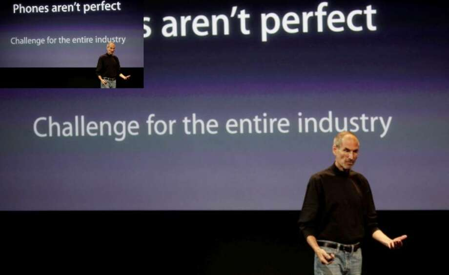 Apple CEO Steve Jobs talks about the Apple iPhone 4 at Apple headquarters in Cupertino, Calif., Friday.