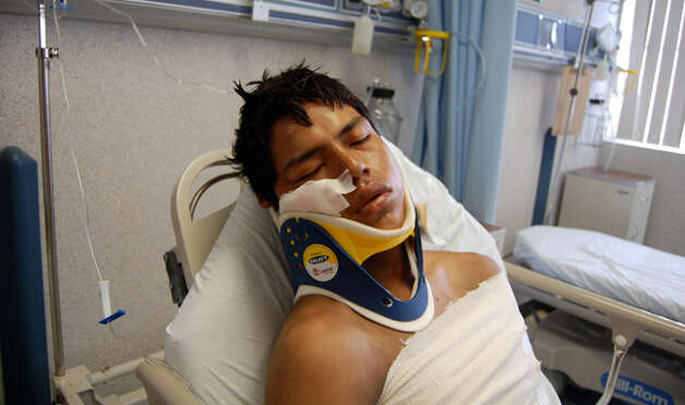 An Ecuadorian migrant identified as Luis Fredy Lala Pomavilla rests at a hospital in Matamoros, Mexico, in the wake of the carnage.