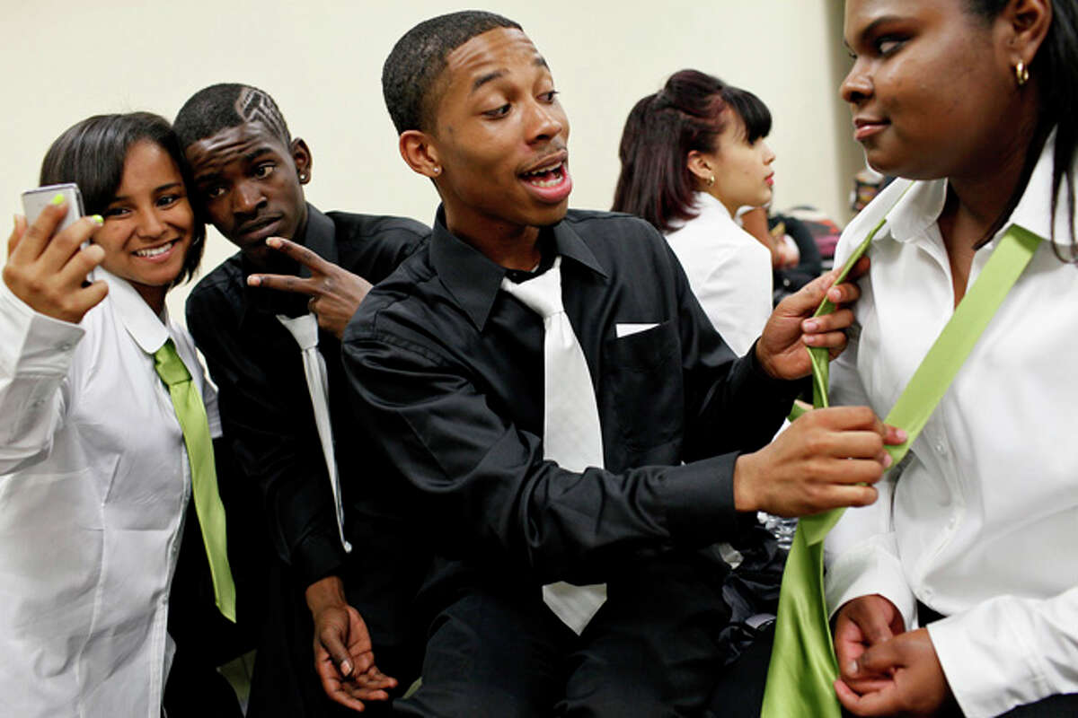 Senior Desiree Meadows, from left, junior Tommy Stringfellow and seniors Diamond Moss and Abbie Bellinger get ready to compete in the Sam Houston Step Show at the school on Friday, March 26, 2010. Sam competed against several other schools and won first place.