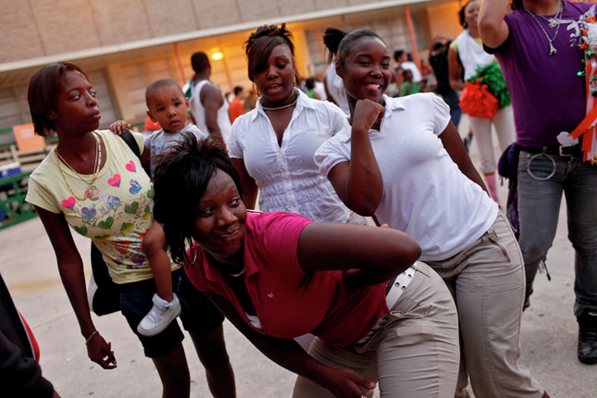 Senior Mary Fitzgerald, left, dances with friends during the fall carnival at the school on Thursday, Oct. 15, 2009.