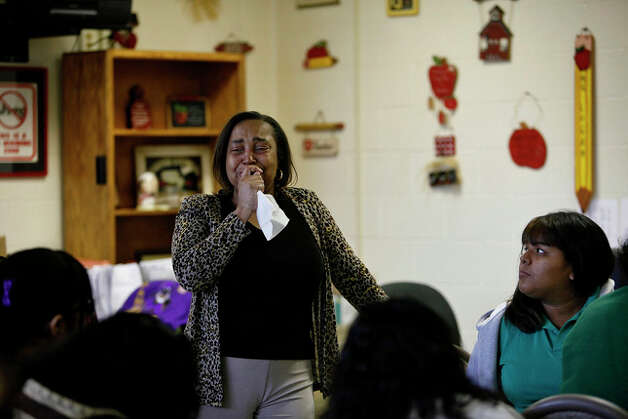 Culinary arts instructor Sherry Logan cries as she talks to her class about their classmate Tiffany James during their first day back at school since Tiffany stabbed and killed her boyfriend, Antwan Wolford. A counselor also talked with the students. Photo: LISA KRANTZ, Lisa Krantz/Express-News / SAN ANTONIO EXPRESS-NEWS