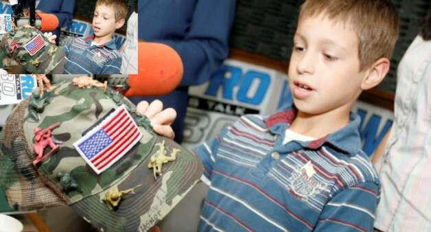 David Morales, 8, from Coventry, R.I., shows his decorated army hat.