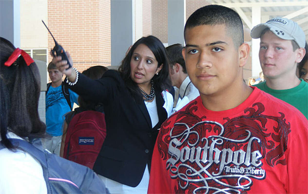 Judson High School Principal Kristina Vidaurri (center) waves students into the new building on the first day of school.