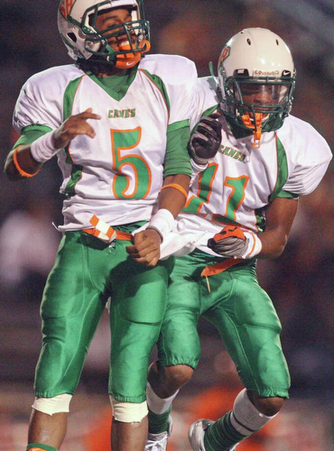 Sam Houston's Jhurell Jackson (left) celebrates with teammate Leo Thomas Jr. after scoring a touchdown against Brackenridge Friday Aug 27, 2010 at Alamo Stadium. The Hurricanes won 43-14. / eaornelas@express-news.net