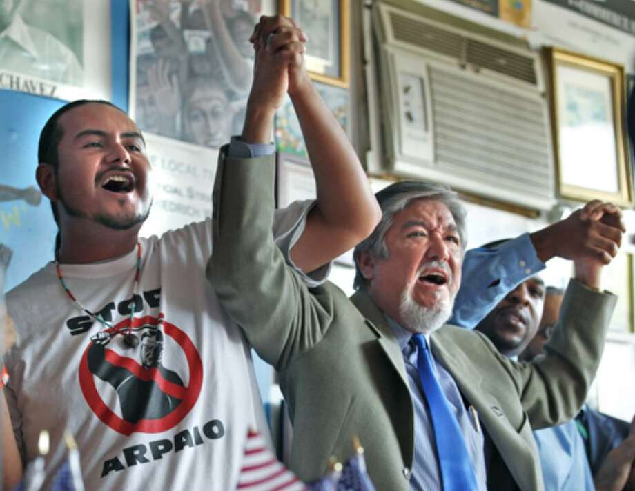 Community organizer Orlando Arenas of Arizona (from left), LULAC's Jaime Martinez and Taj Matthews of the Claude & ZerNona Black Foundation join hands in solidarity at the Labor Council for Latin American Advancement's news conference.