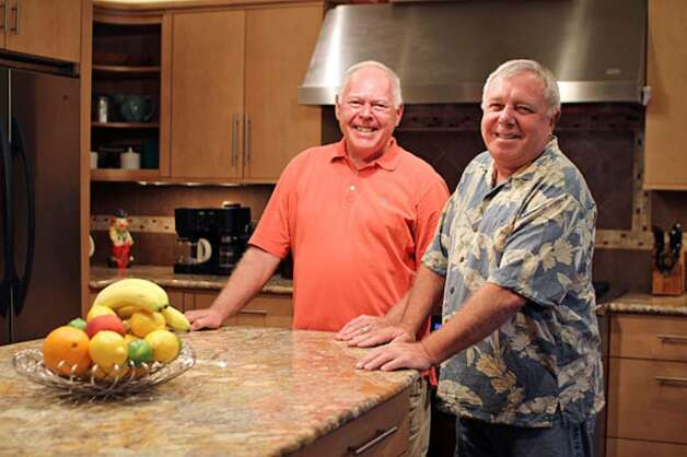 Steve LaMonica (right) and John Kirk spent a year fashioning a kitchen from what had been the original master bedroom of their Hollywood Park home.