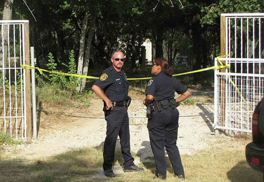 Deputies with the Bexar County Sheriff's Office stand outside the gates of a South Bexar County home where a man was fatally stabbed and a woman was injured.