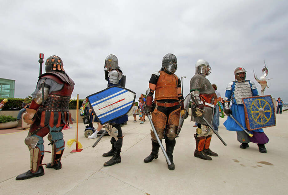 Comic-Con attendees dressed in armor wait for a mock battle. / FR59680 AP