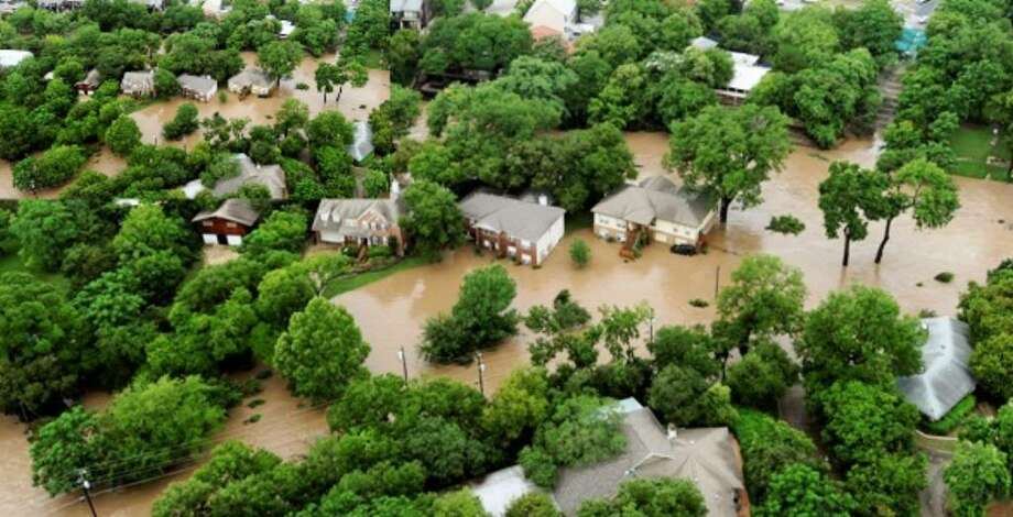 A New Braunfels neighborhood is saturated in flood water after heavy rain caused the Guadalupe River to over overlow its banks on Wednesday, June 9, 2010.