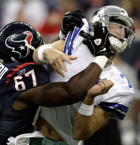 Cowboys third-string quarterback Stephen McGee gets rocked by Texans defensive tackle Malcolm Sheppard after throwing an incomplete pass Saturday. Houston won 23-7.