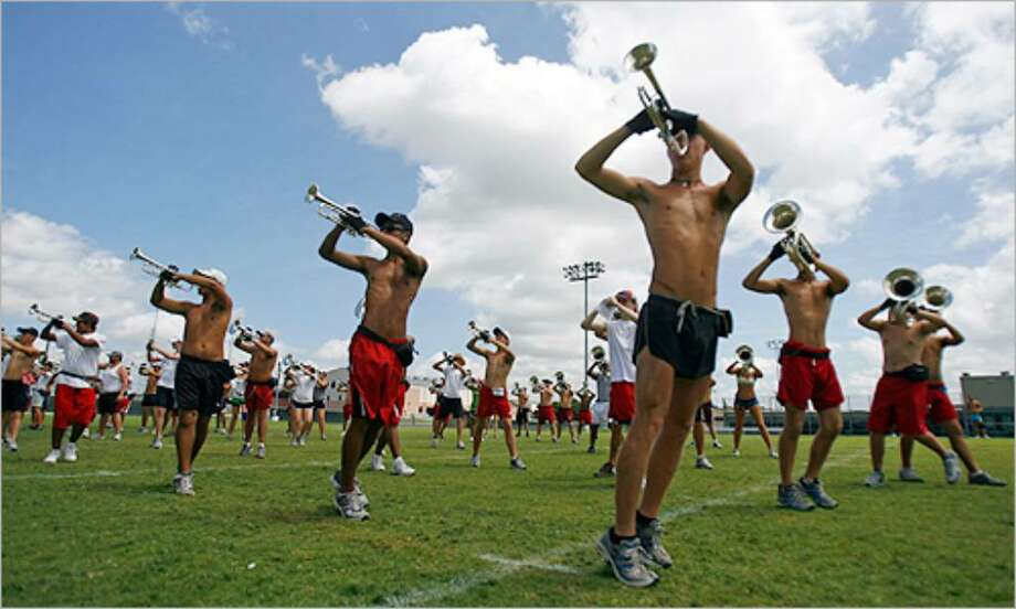 The Crossmen horn line rehearses at Blossom Athletic Center. The team's national tour started Saturday.