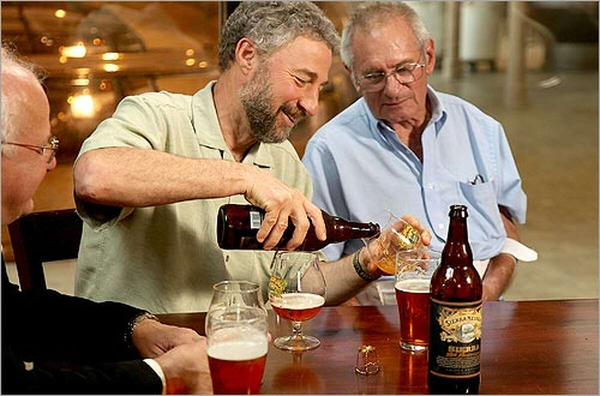Sierra Nevada founder Ken Grossman (left) visit with Jack McAuliffe at the Sierra Nevada brewery, which is celebrating the brewery's 30th anniversary.