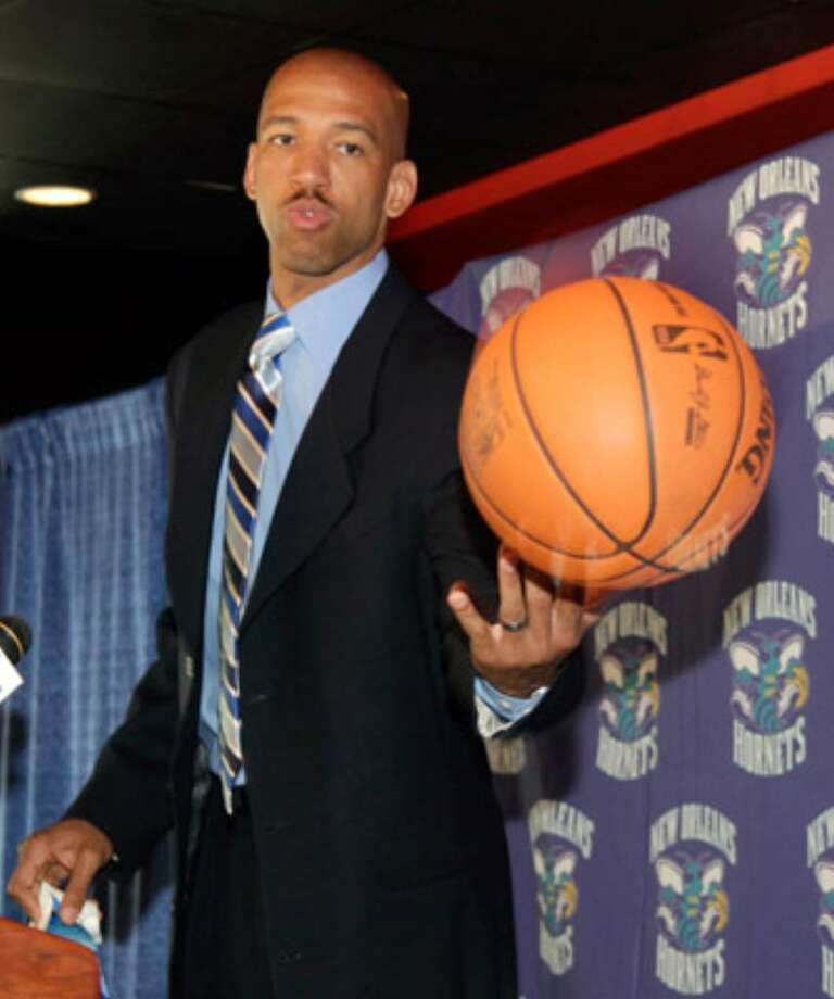 Monty Williams tosses a basketball during his introduction Tuesday as coach of the New Orleans Hornets.