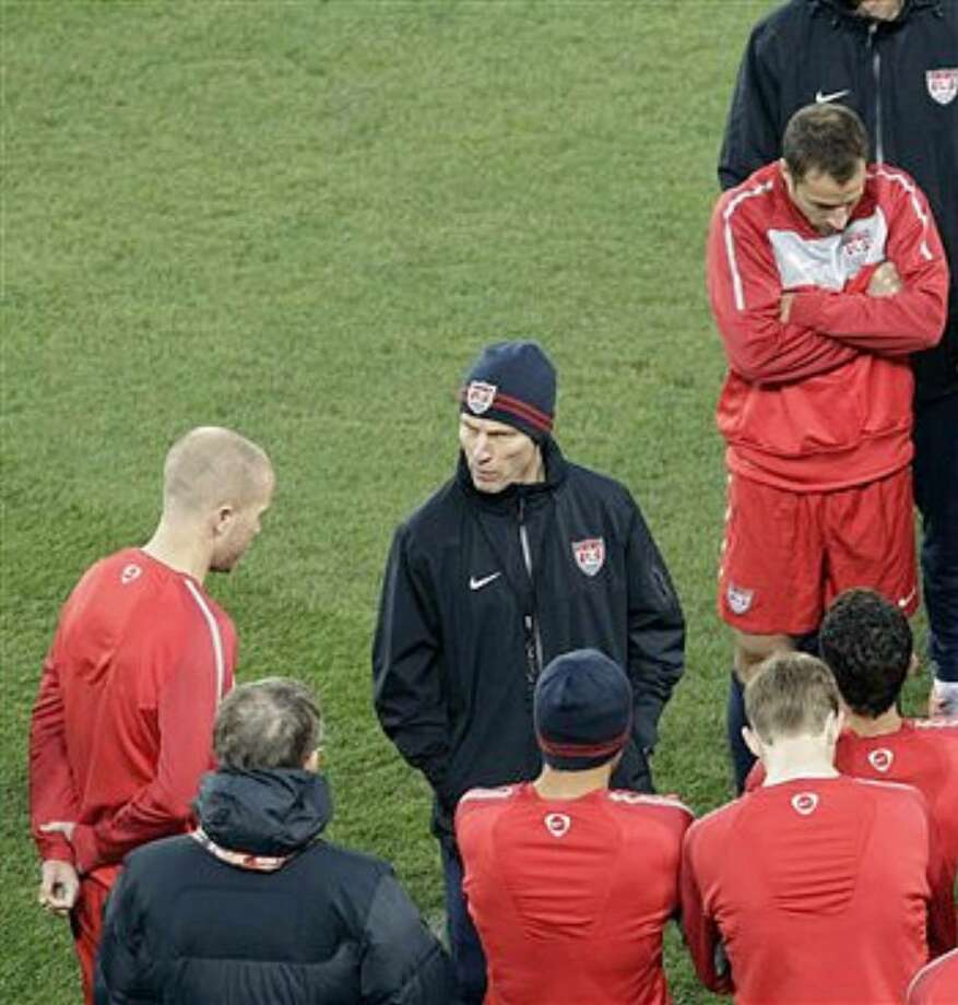 United States coach Bob Bradley (center) talks to his son, midfielder Michael Bradley (far left), during a training session in Johannesburg on Thursday.