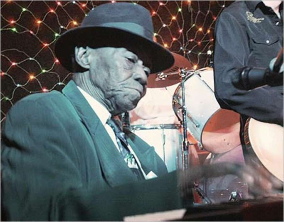 "Blues-piano legend Joe Williams ""Pinetop"" Perkins will join others blues piano greats on stage at Sam's Burger Joint Friday night."