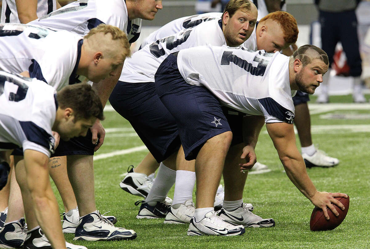 Rookie lineman Phil Costa (67) still shows his new haircut during walk-thrus at the final practice session at the Dallas Cowboys training camp at the Alamodome on Friday, August 6, 2010. The tradition of giving rookie lineman unique haircuts by veteran players was kept alive this year.