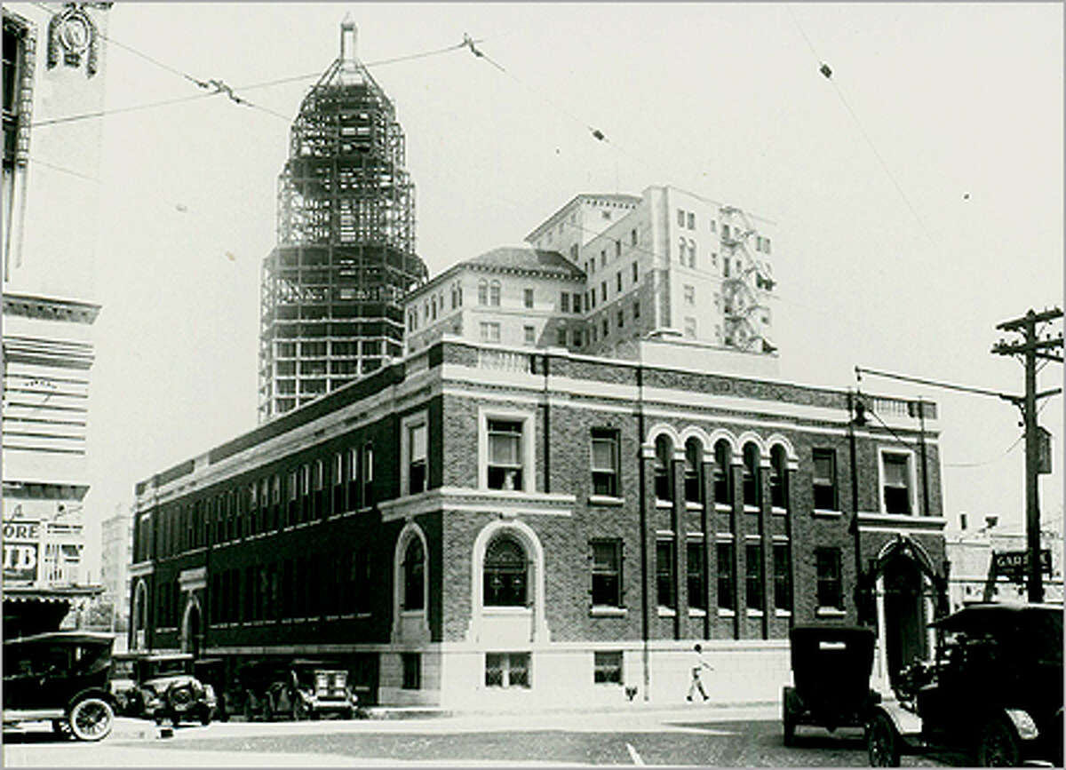 The Tower Life Building, shown under construction in the background, was constructed by brothers Albert and Jim Smith, owner of Smith Bros. Properties.