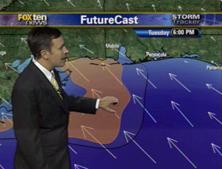 Meteorologist Jason Smith shows WALA-TV FOX10 viewers the projected path of oil spewing from the Deepwater Horizon rig in the Gulf of Mexico during a broadcast at the FOX10 television station in Mobile, Ala.