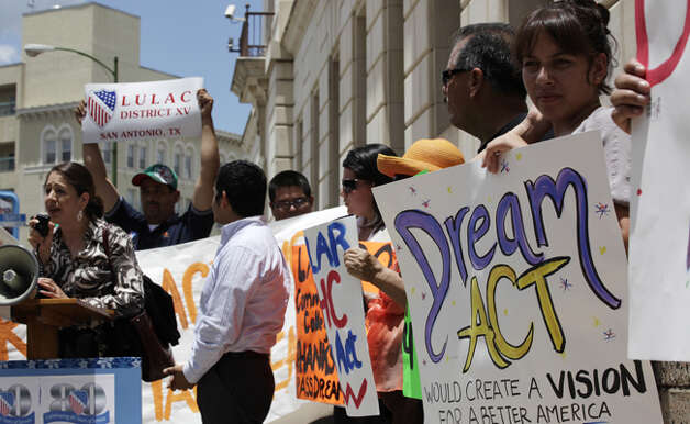 Immigration reform advocates gather in front of the office of U.S. Rep. Henry Cuellar, D-Laredo, in support of the DREAM Act, which would grant citizenship to some unauthorized immigrants in college. Cuellar has agreed to co-sponsor the bill.