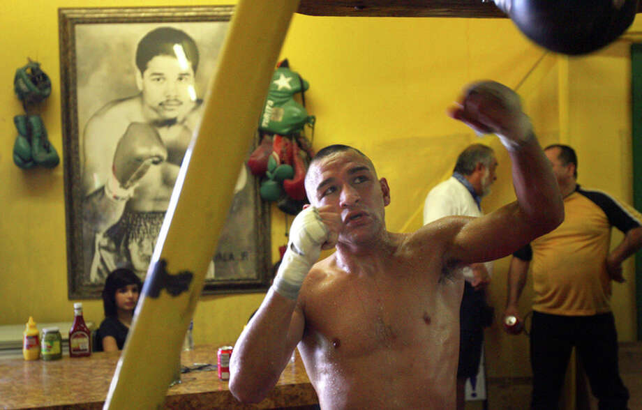 "FILE: Gabriel Elizondo works out at Zarzamora Street Gym in preparation for the ""Latin Fury 15"" card at the Alamodome. / jdavenport@express-news.net"