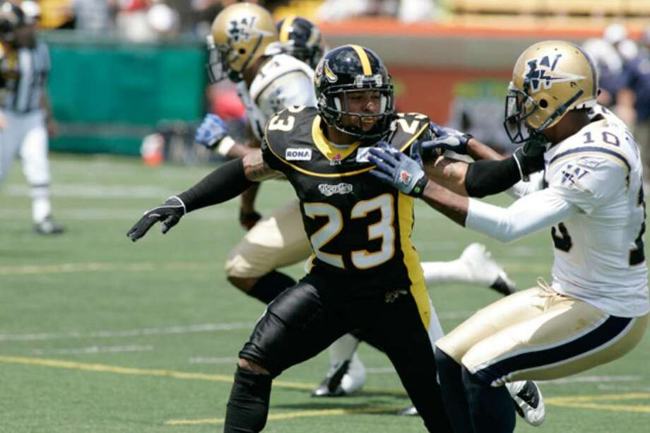 Former Texas State defensive back Will Heyward (23), matched up against Winnipeg's Chris Davis in a CFL preseason game, is contributing for the Tiger-Cats. Heyward's long path to pro football included many sacrifices by him and his family.