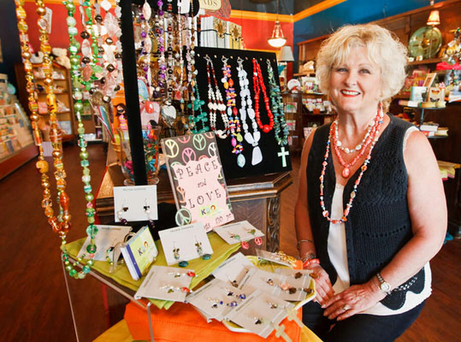 Local artist Kathi O'Bryant shows off a collection of her jewelry available for purchase at Seasons Gift Shop, 20540 Hwy 46 W, Spring Branch. / Prime Time Newspapers 2010