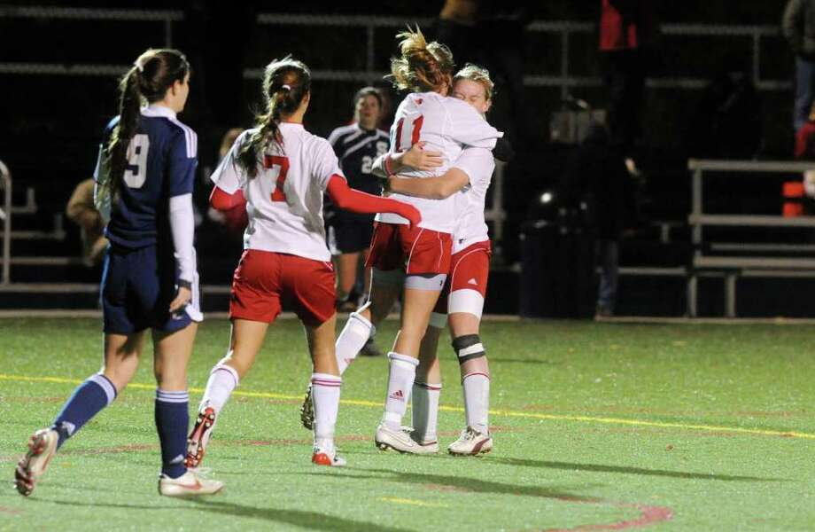 The Cardinals celebrate Shannon Colligan's goal as Greenwich and Staples face off in the FCIAC girls soccer semifinals at Wilton High School in Wilton, Conn., Monday, November 1, 2010. Photo: Keelin Daly / Stamford Advocate