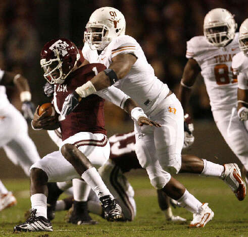 Texas? Kheeston Randall, sacking Texas A&M quarterback Jerrod Johnson, is the Horns? most experienced defensive tackle.