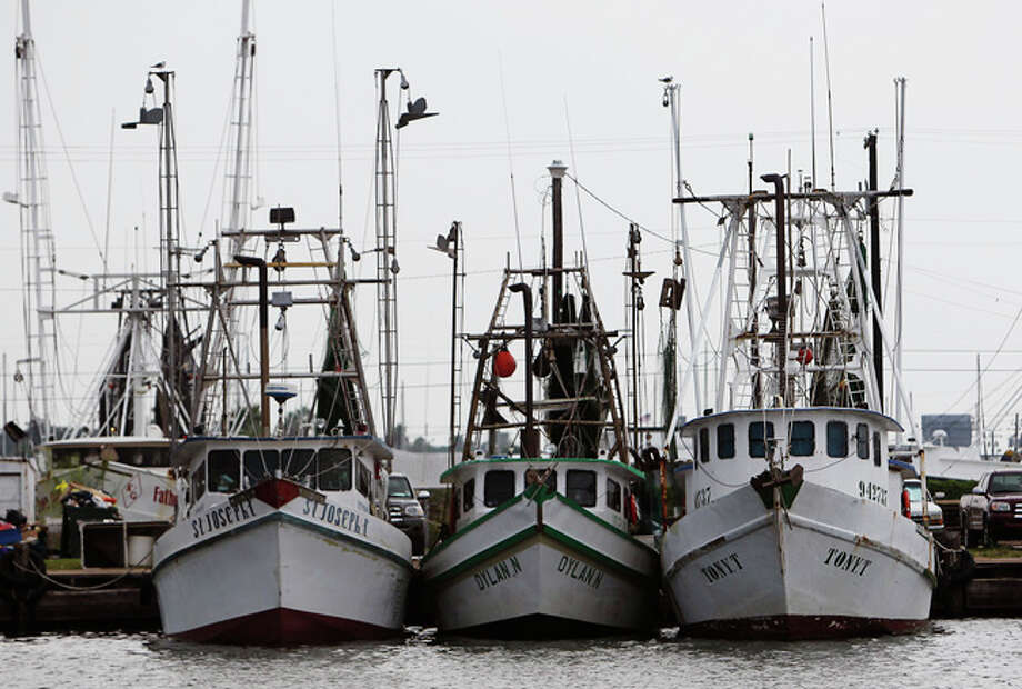 Shrimp trawlers docked in Palacios, Texas recently. / San Antonio Express-News