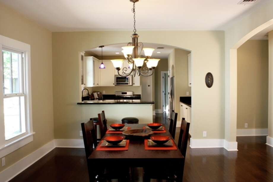 Tom Tarrant refurbished the exterior of a home at 323 Thorman Place and put in an open floor plan and a kitchen with granite countertops and stainless steel appliances.