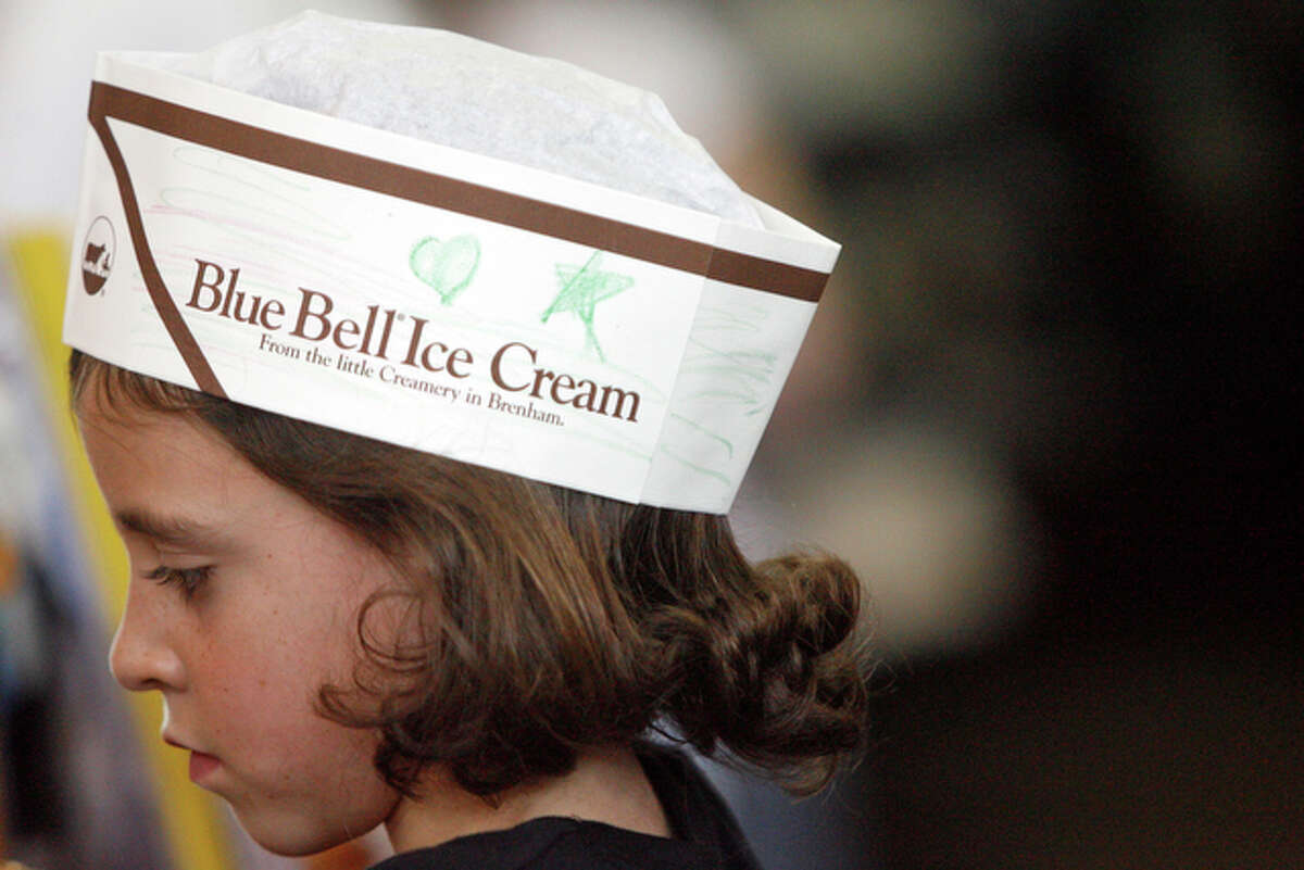 Carly Wulfsberg, 9, wears a free hat provided by Blue Bell.