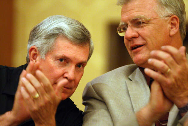 Texas coach Mack Brown (left) listens to Texas A&M coach Mike Sherman at the Texas High School Coaches Association convention.