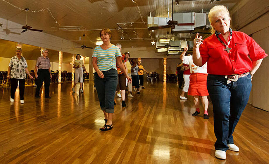 Line dancers strutt their stuff during a class at Braun Hall, 9723 Braun Road. Line dancing classes are held there Tuesday evenings and Friday mornings, and baseball and other activities keep folks coming.