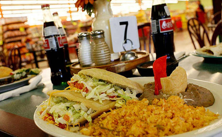 Fill up on a gorditas picadillo plate at El Folklor in La Fiesta Supermarket on Ingram Road before grocery shopping. / SAN ANTONIO EXPRESS-NEWS