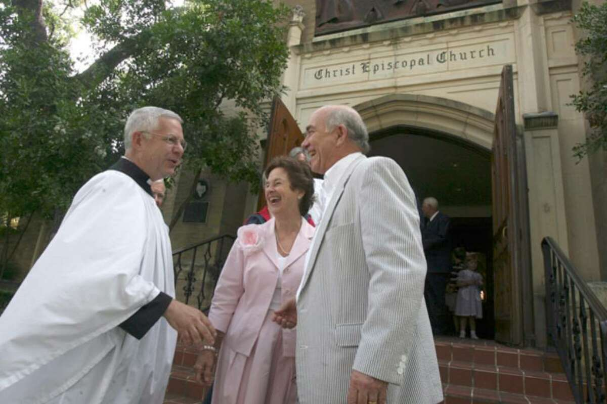 The Rev. Chuck Collins greets Susan and Bill Galbreath after Collins' last service at Christ Episcopal Church in late May. He retired over concerns about the national Episcopal Church's liberal changes, including approval of gay and lesbian clergy.