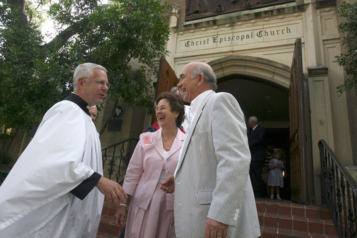 The Rev. Chuck Collins greets Susan and Bill Galbreath after Collins? last service at Christ Episcopal Church in late May. He retired over concerns about the national Episcopal Church?s liberal changes, including approval of gay and lesbian clergy.