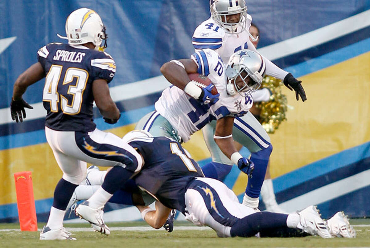 Dallas Cowboys safety Barry Church is tackled by Chargers quarterback Philip Rivers after an 80-yard fumble return.