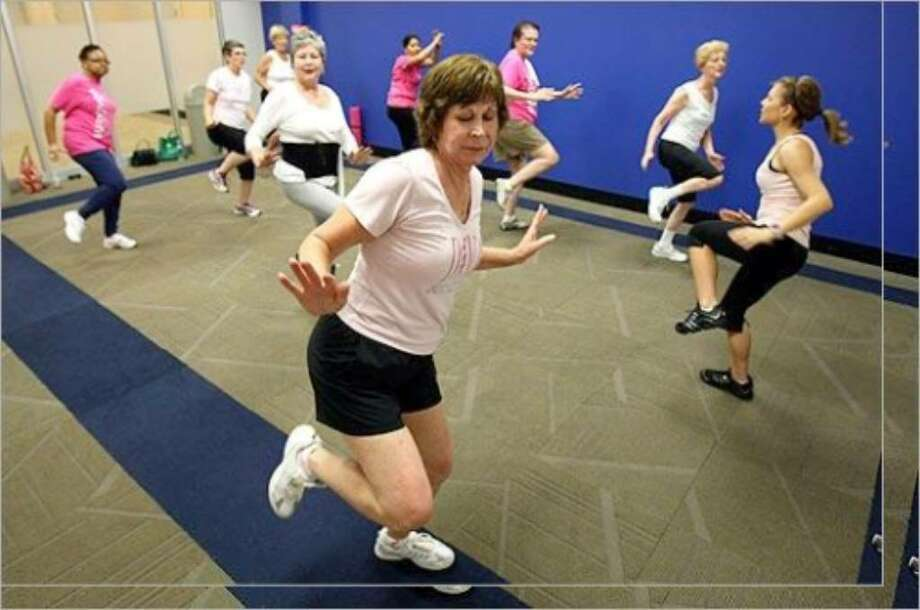 Betsy Achilles works out during a DIVA exercise class.